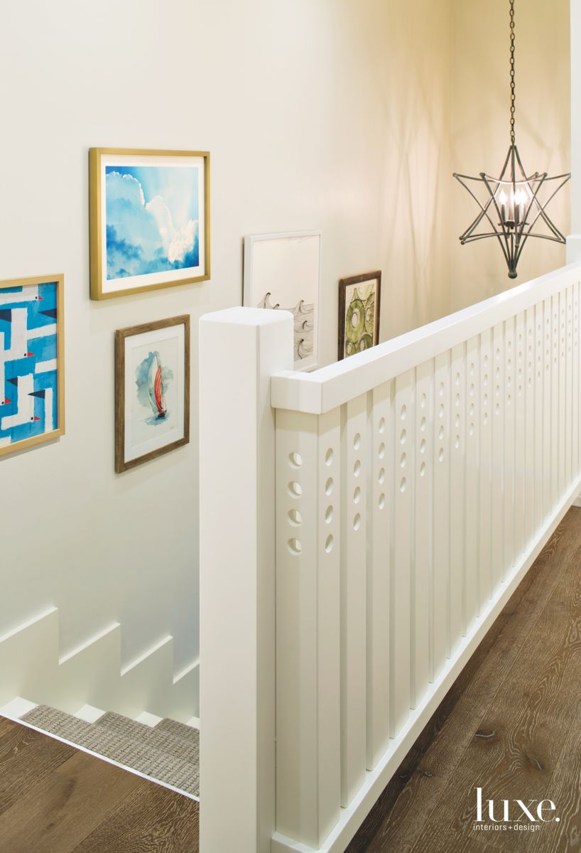 White Railing Staircase with 3D Star Chandelier and Art Gallery Wall
