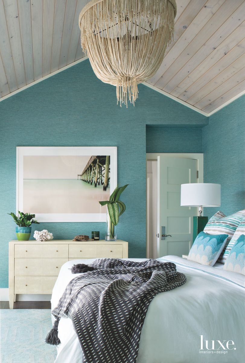 Teal Wallcovering Master Bedroom with Organic Chandelier and Pier Artwork