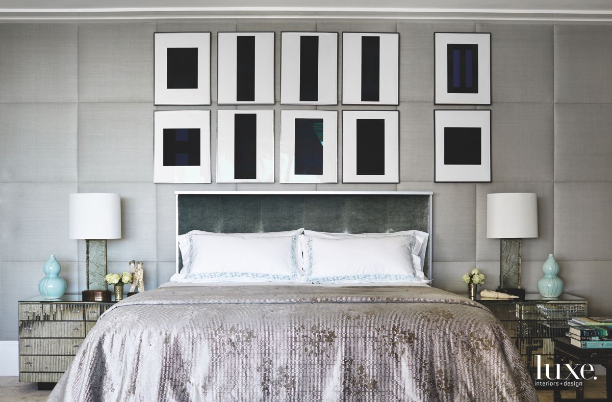 Upholstered Silver Headboard with Black and White Artwork Master Bedroom with Fabric Walls