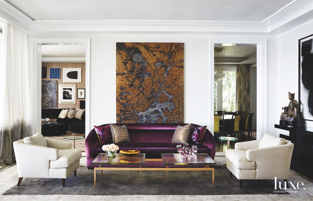 Purple Velvet Sofa Living Room with Organic Color Artwork and Crown Moulding