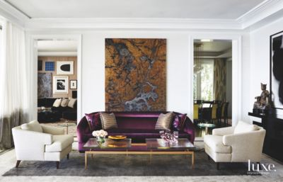 Purple Velvet Sofa Living Room With Organic Color Artwork And Crown Moulding    Luxe Interiors + Design