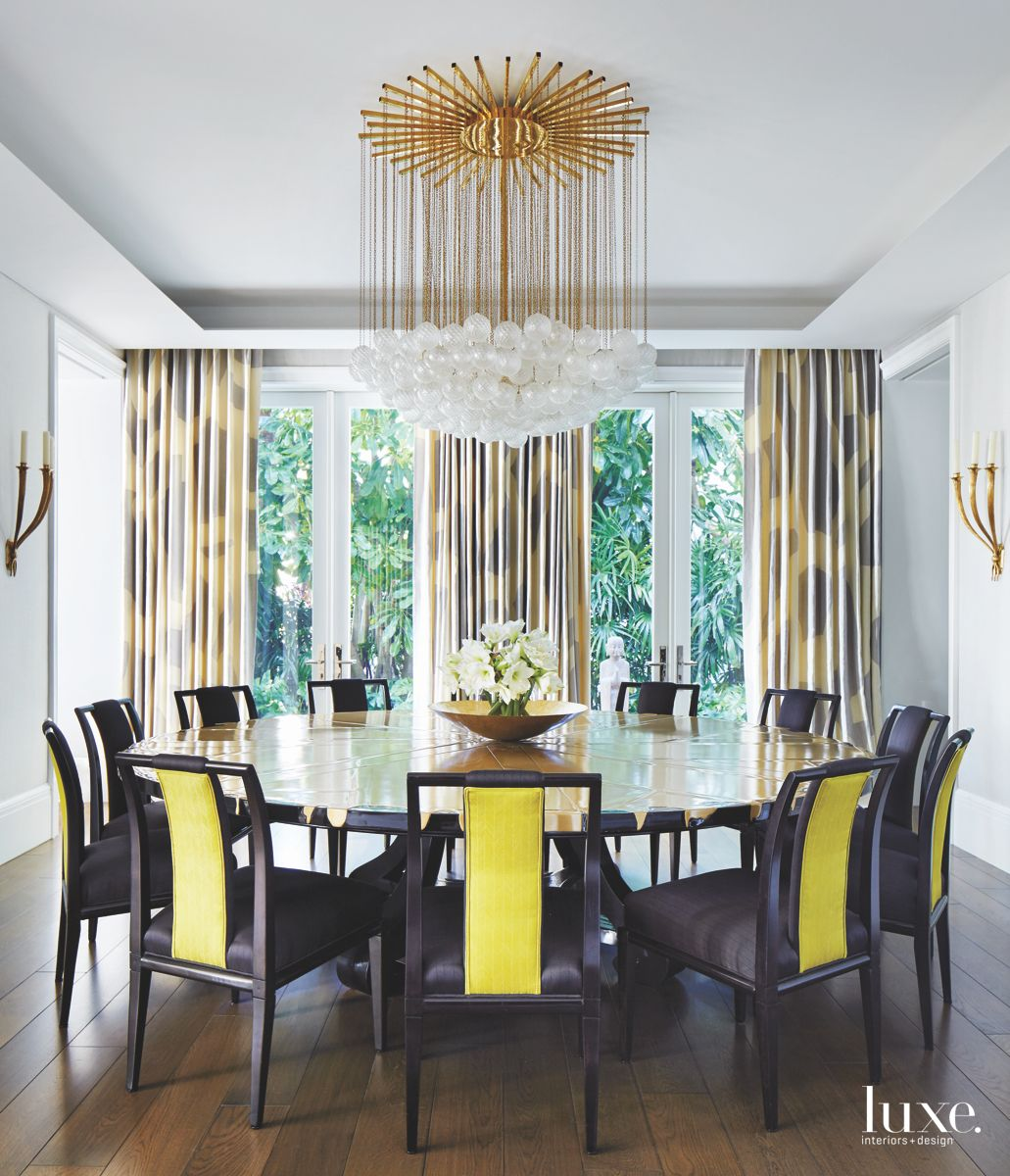 Dangling Statement Starburst Bubble Chandelier with Yellow Striped Chairs