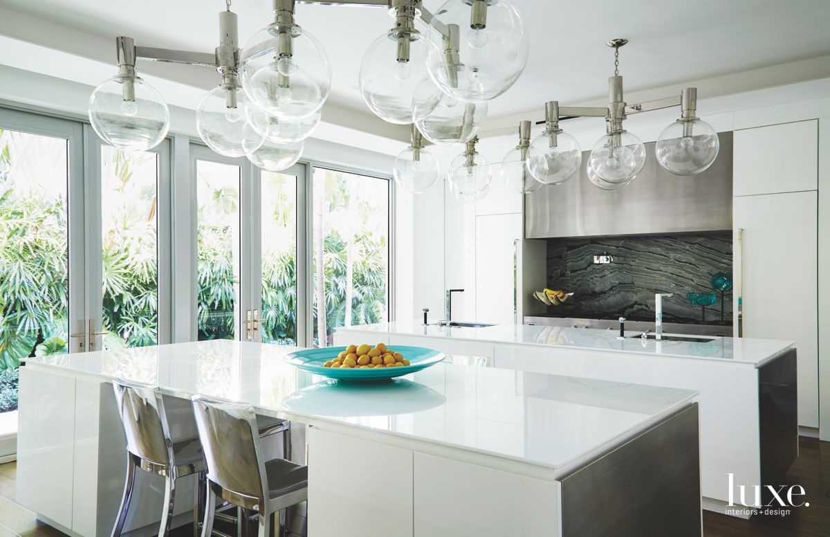 Bubble Chandelier White Kitchen with Stainless Steel Appliances and Chairs with Aqua Bowl