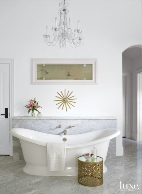 Transitional White Bathroom With Gold Side Table Luxe