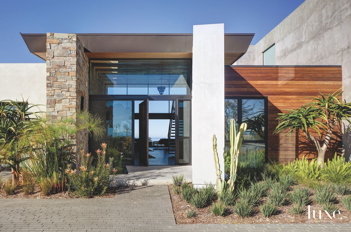 Wood Stone and Steel La Jolla Home Exterior with Glass Door Entryway and Soft Landscape