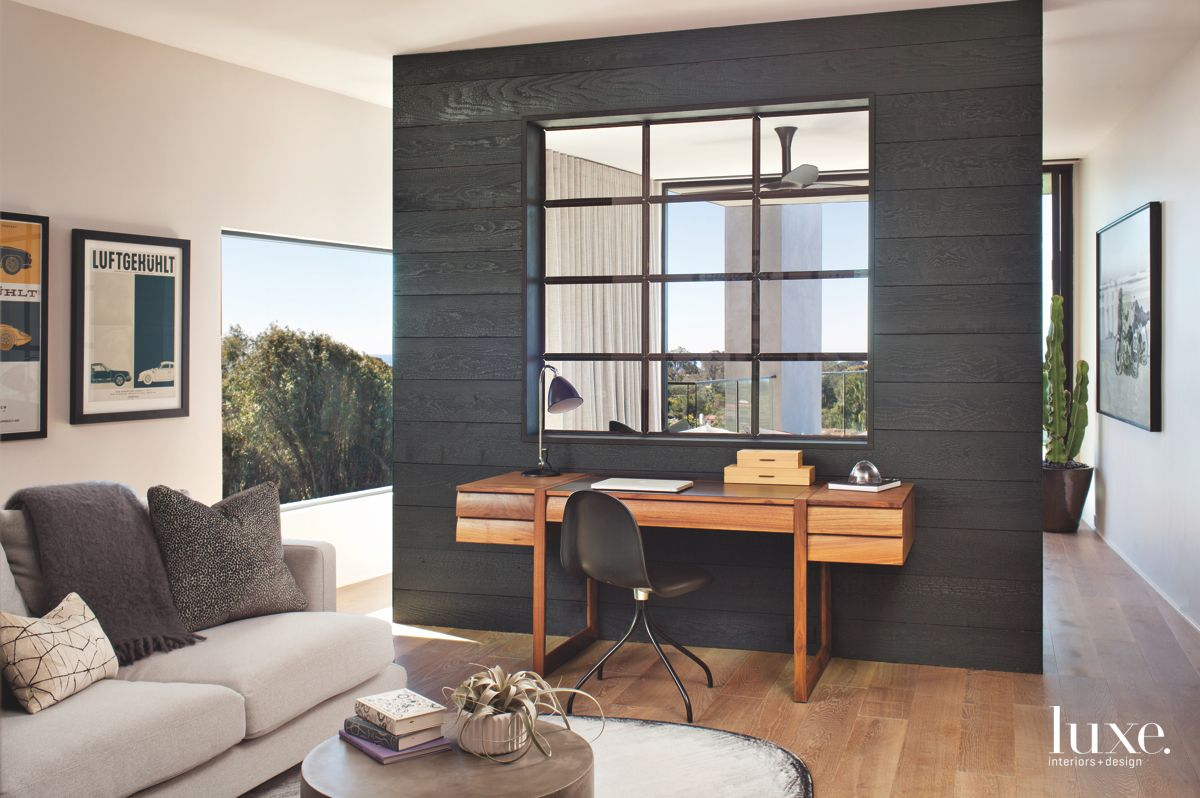 Moody Black Wall and Desk with Window-Like Structure
