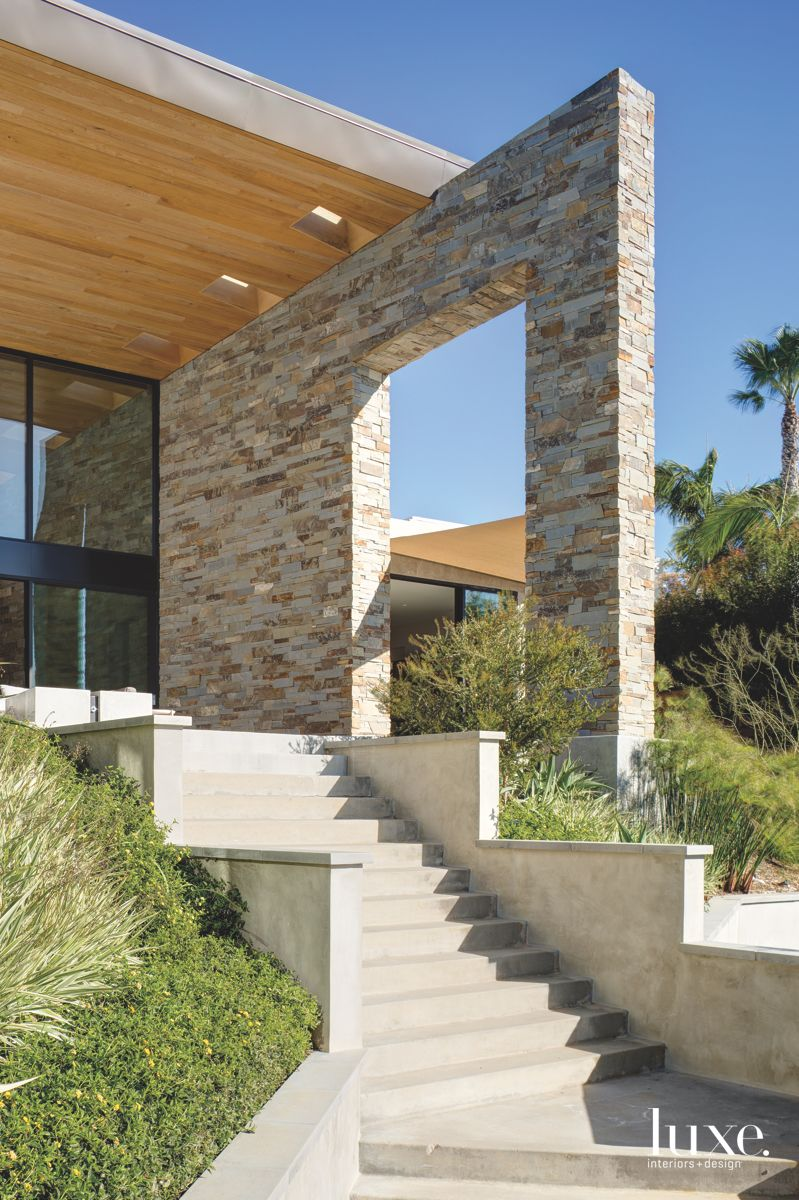Wooded Skylight Exterior Roof with Stone Facade and Stairs