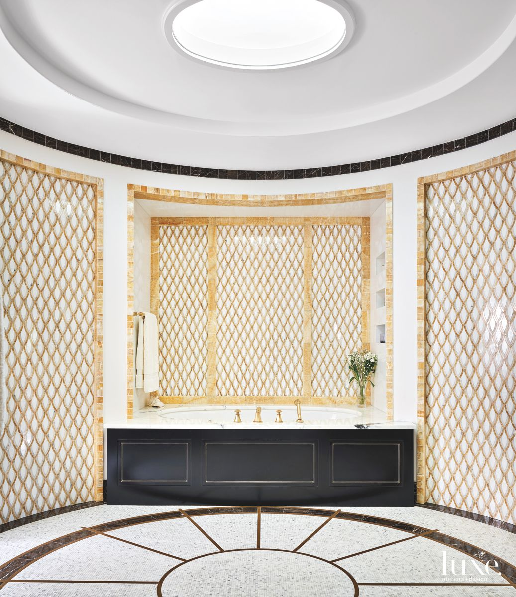 Oval Skylight Gold Master Bathroom with Ornate Pattern