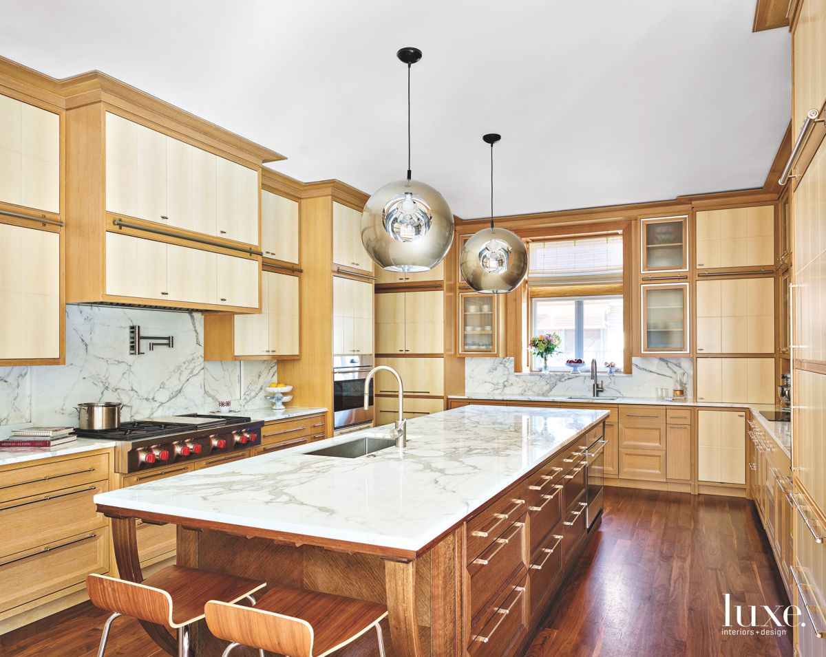 Wood and Marble Kitchen With Chrome Chandelier Pendants