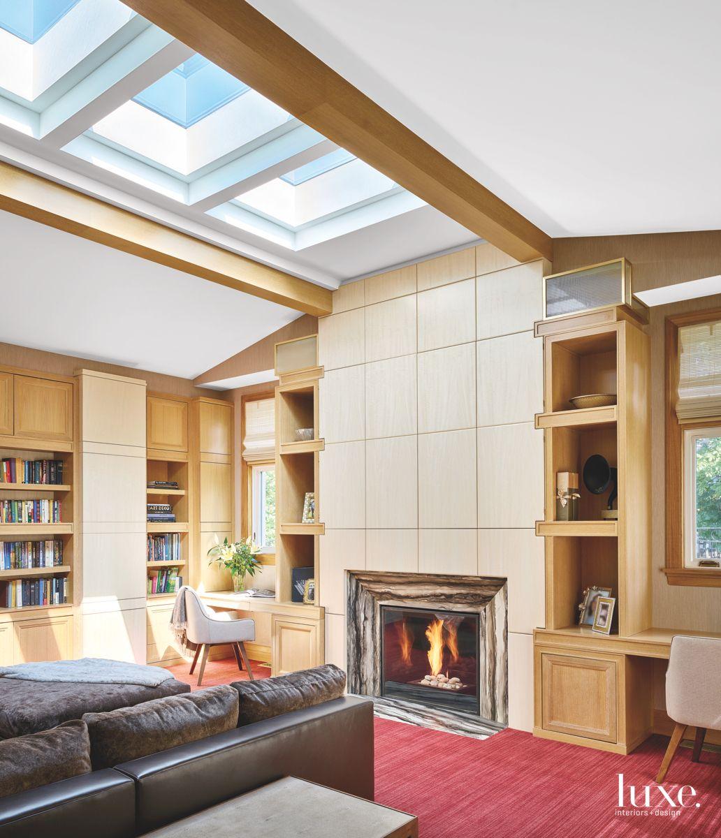 Skylight Light Wooden Den with Fireplace