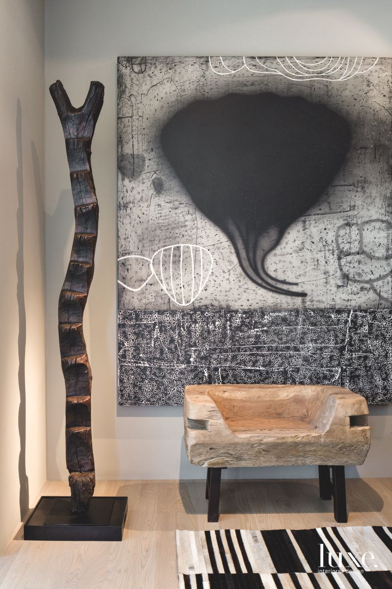 Black Tornado Artwork with Wooden Sculpture with Striped Carpet