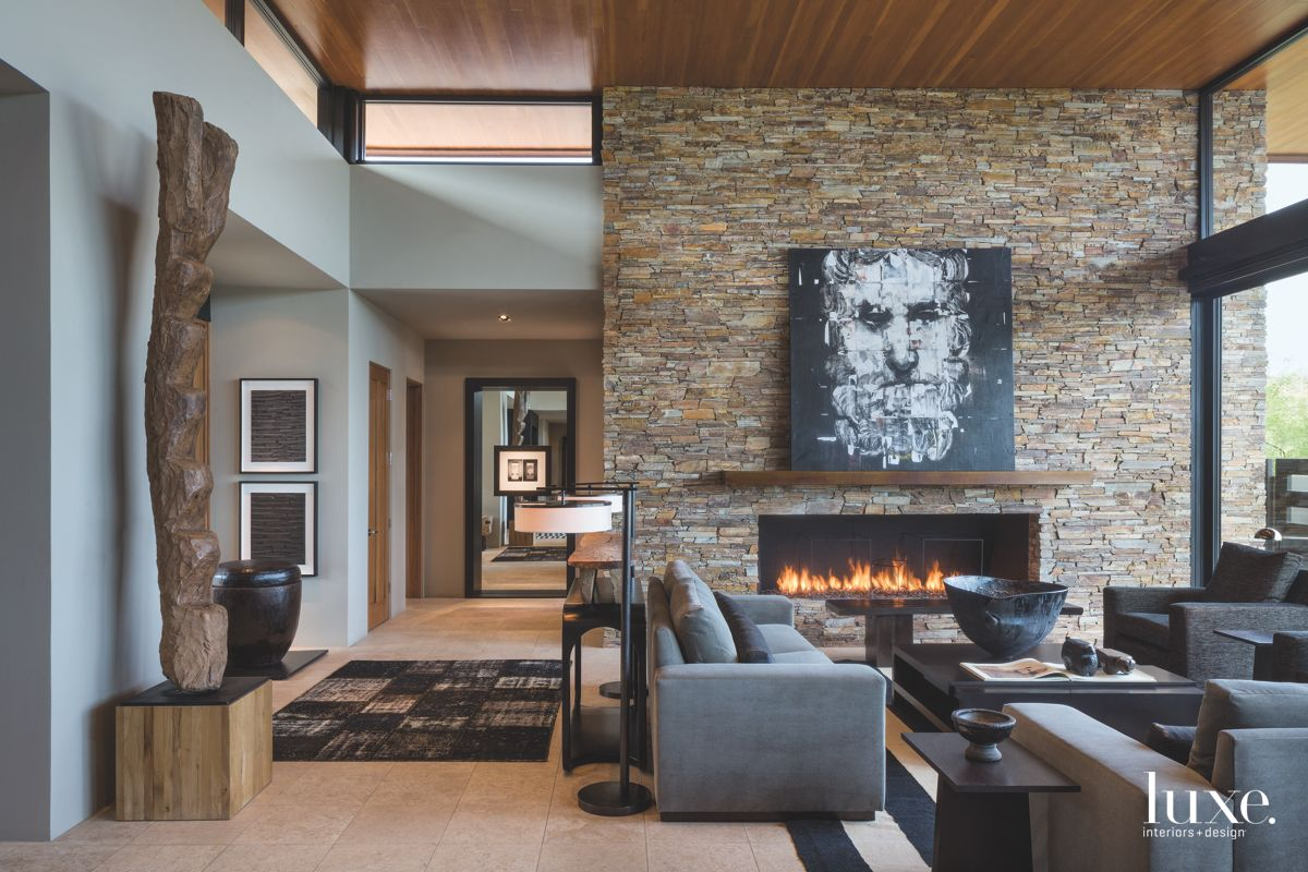 Roaring Stone Floor To Ceiling Fire Wall with Clerestory Windows