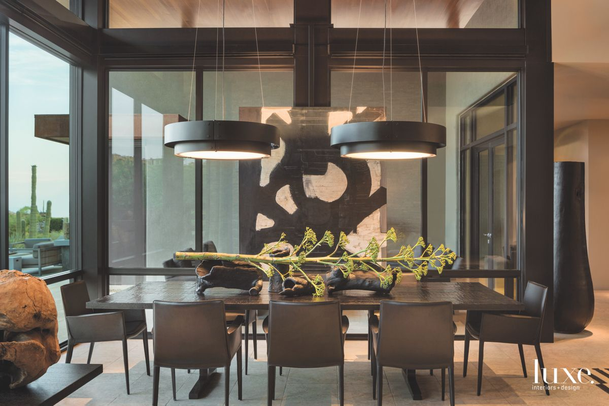 Twin Pendant Lighting Dining Room With Natural Branch and Black and White Artwork