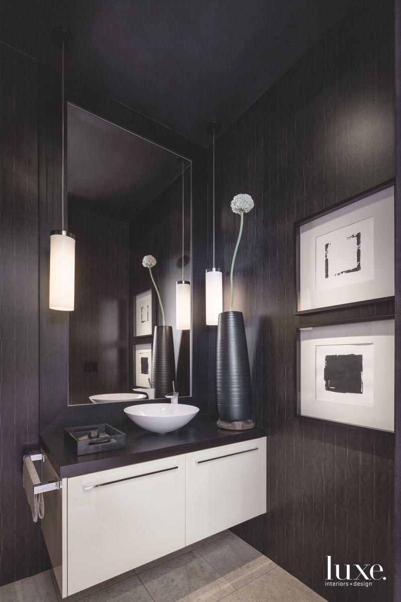 Moody All Black Powder Room with Sleek Flower Vase Rectangular Mirror and Artwork