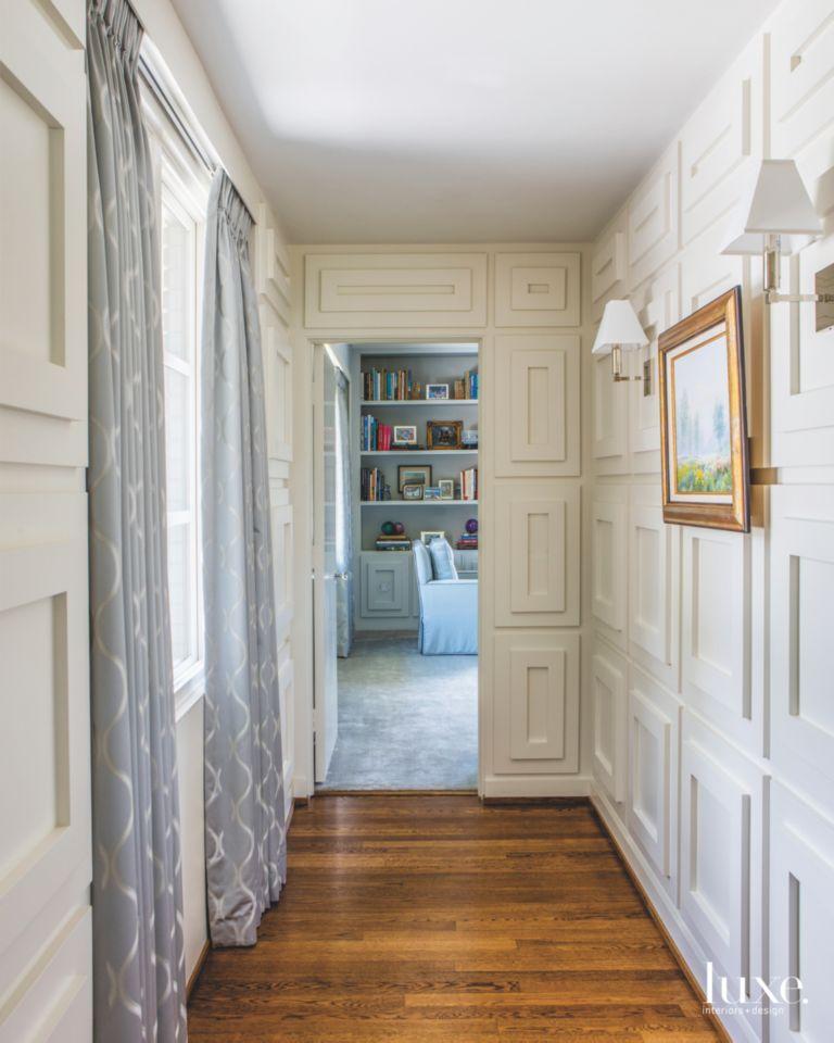 Rectangular White Wood Paneling Hallway With Framed Artwork And