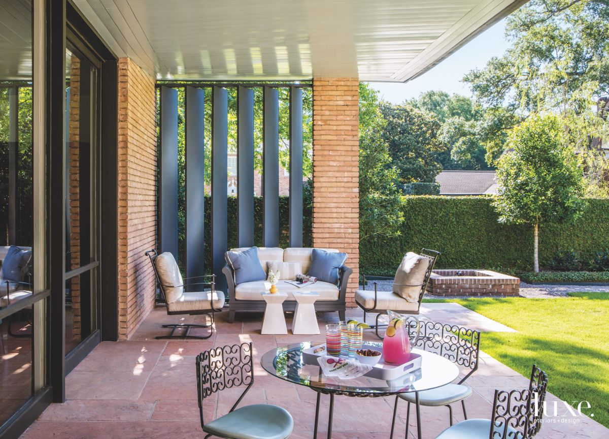 Cozy Contemporary Outdoor Seating Furniture with Wrought Iron Chairs and Stone Patio