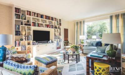 Bookshelf TV Wall With Books, Colorful Patterns And Eclectic Furnishings
