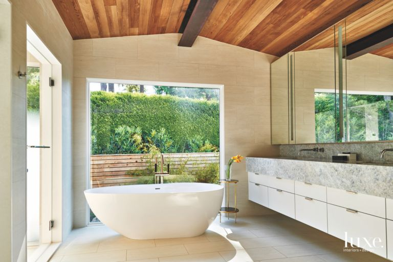 Expansive Window Master Bathroom with Large Soaking Tub and Floating ...