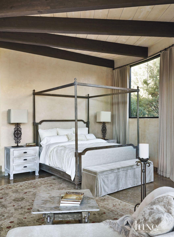 Mediterranean Cream Master Bedroom with Exposed Beams