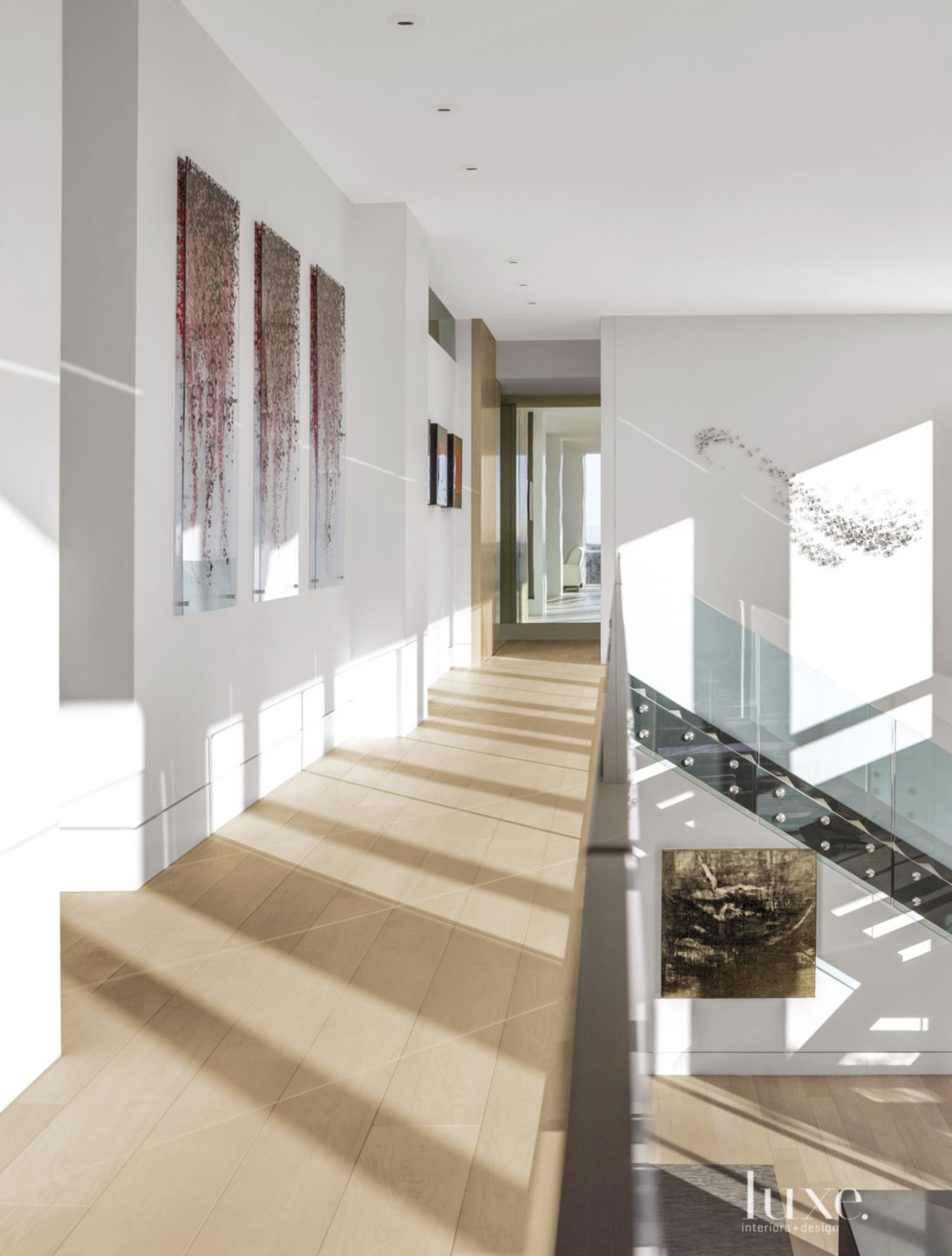Contemporary Neutral Hallway with Glass Railing