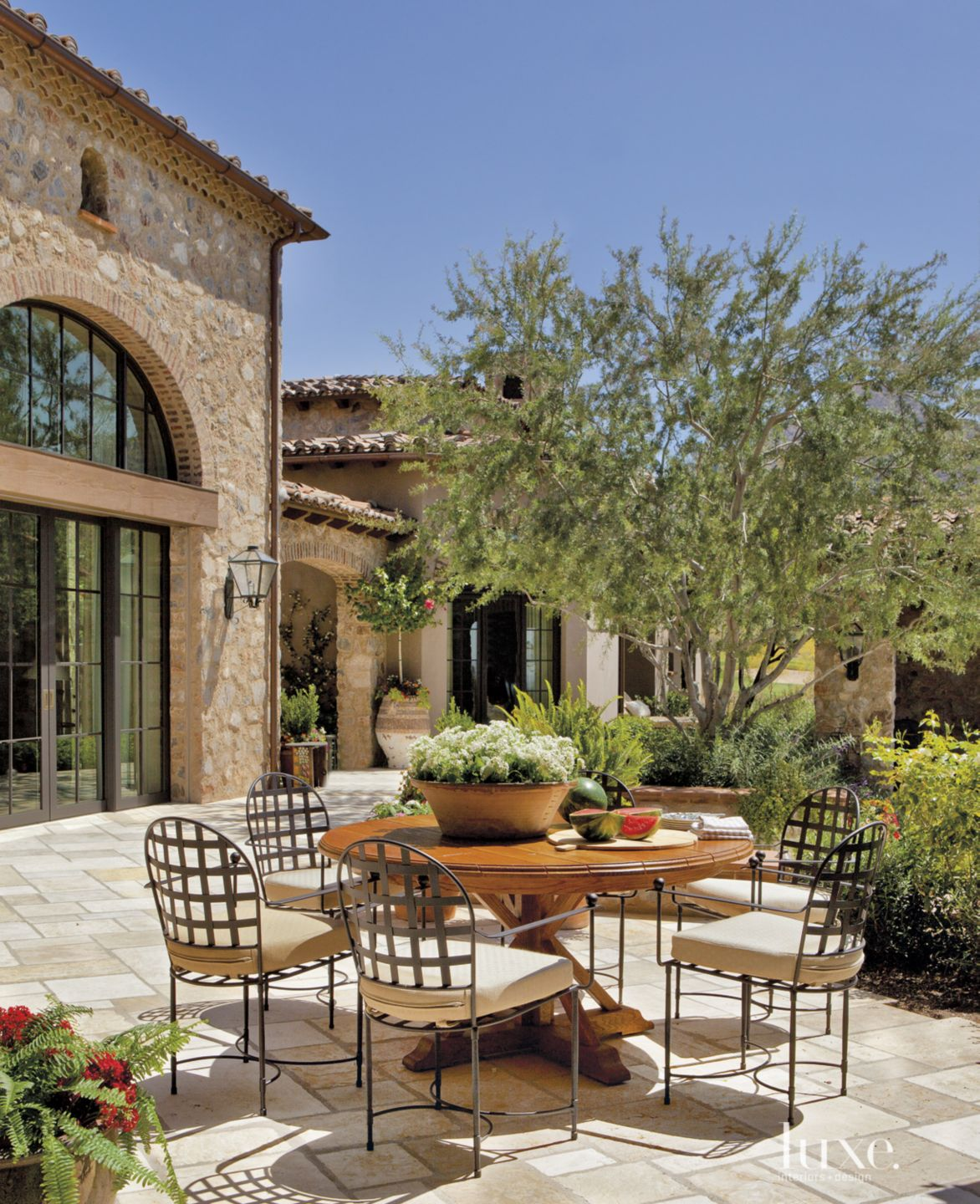 Mediterranean Neutral Breakfast Patio with Iron Dining Chairs