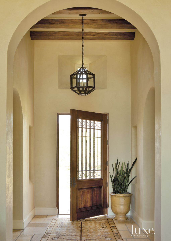Mediterranean Cream Foyer with Custom Lantern