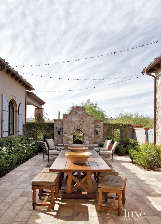 Mediterranean Neutral Courtyard with Garden Lights