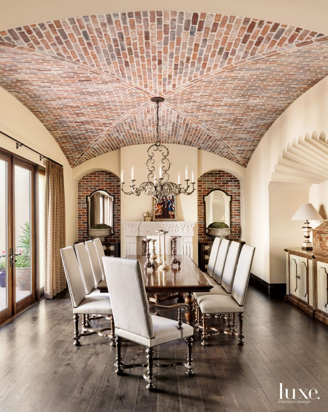 Spanish Mission-Inspired Traditional Cream Dining Room with Brick Ceiling