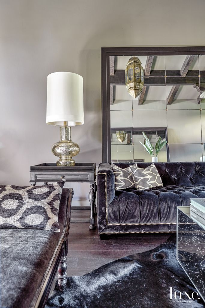 Transitional Cream Living Room with Tufted Black Sofas ...