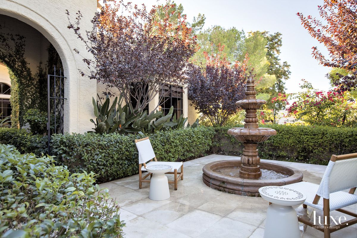 Transitional Neutral Entry Courtyard with Purple Plum Trees