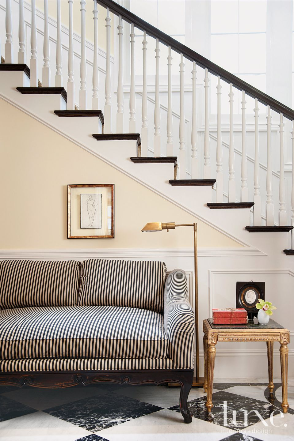 Traditional Neutral Foyer with Striped Sofa