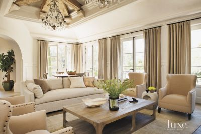 contemporary cream living room with exposed beams luxe interiors
