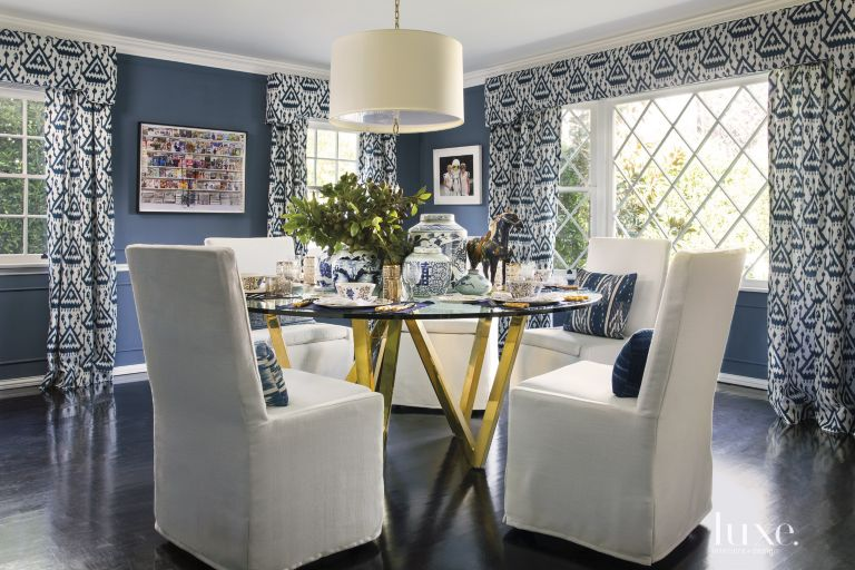 Eclectic Blue Dining Room With Polished Brass Table