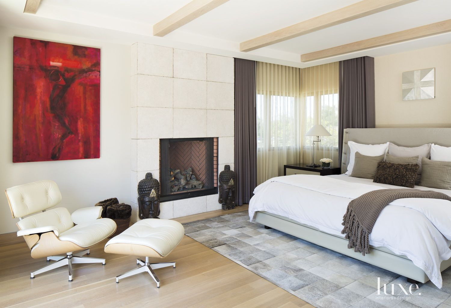 Contemporary White Bedroom with Eames Chair and Ottoman