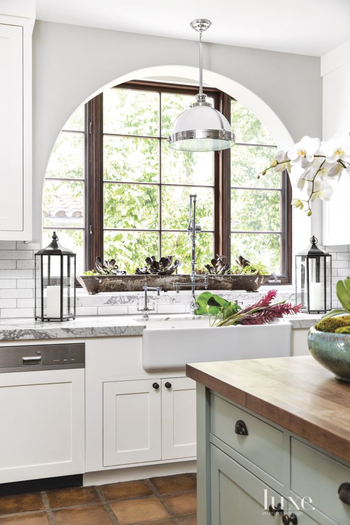 Spanish Colonial White Kitchen with Archways - Luxe Interiors + Design
