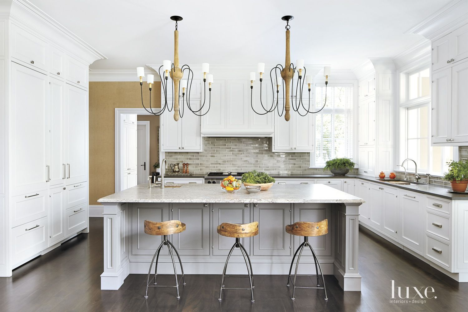 Traditional White Kitchen with Matching Chandeliers