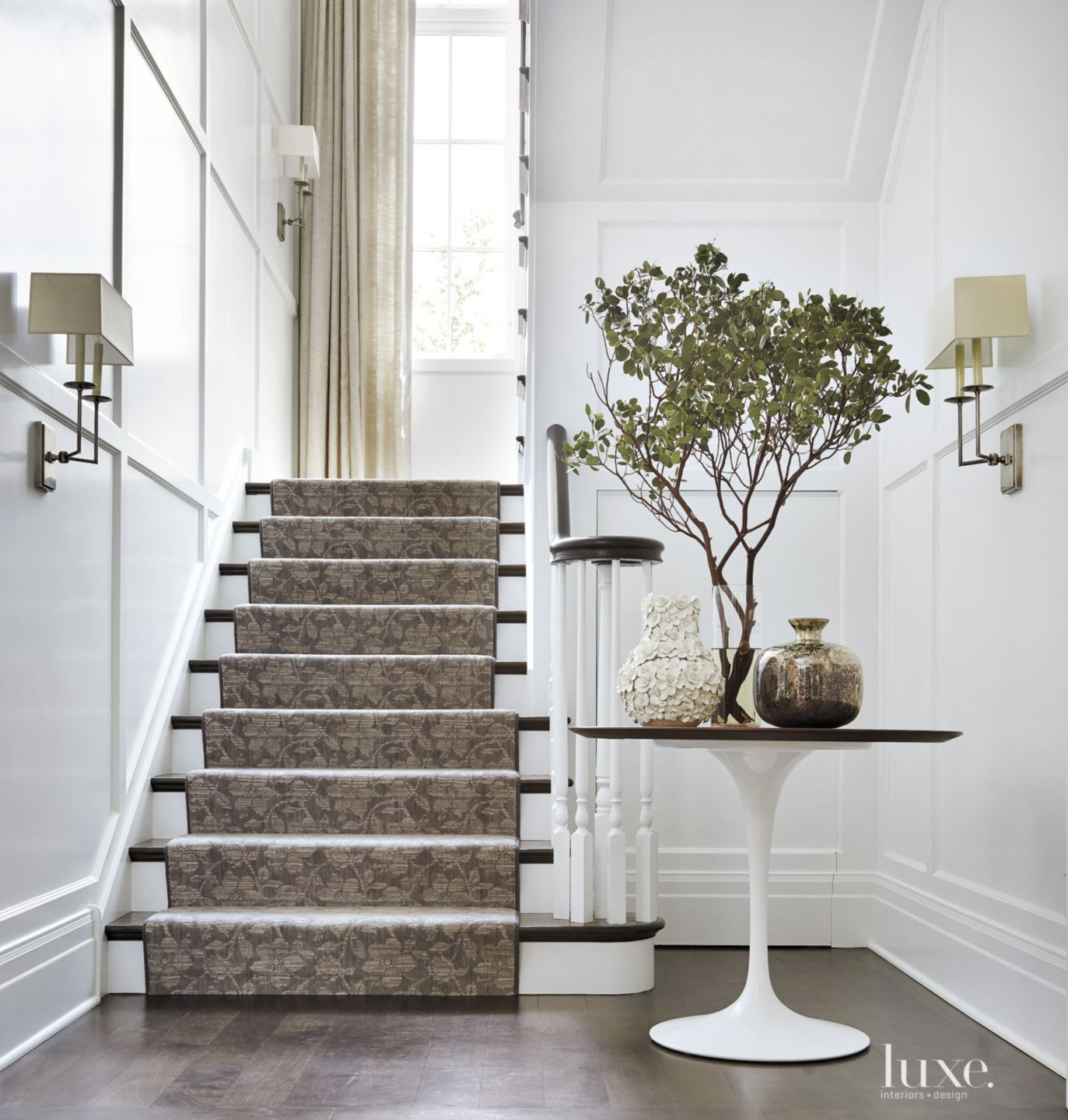 Traditional White Staircase with Elaborate Millwork