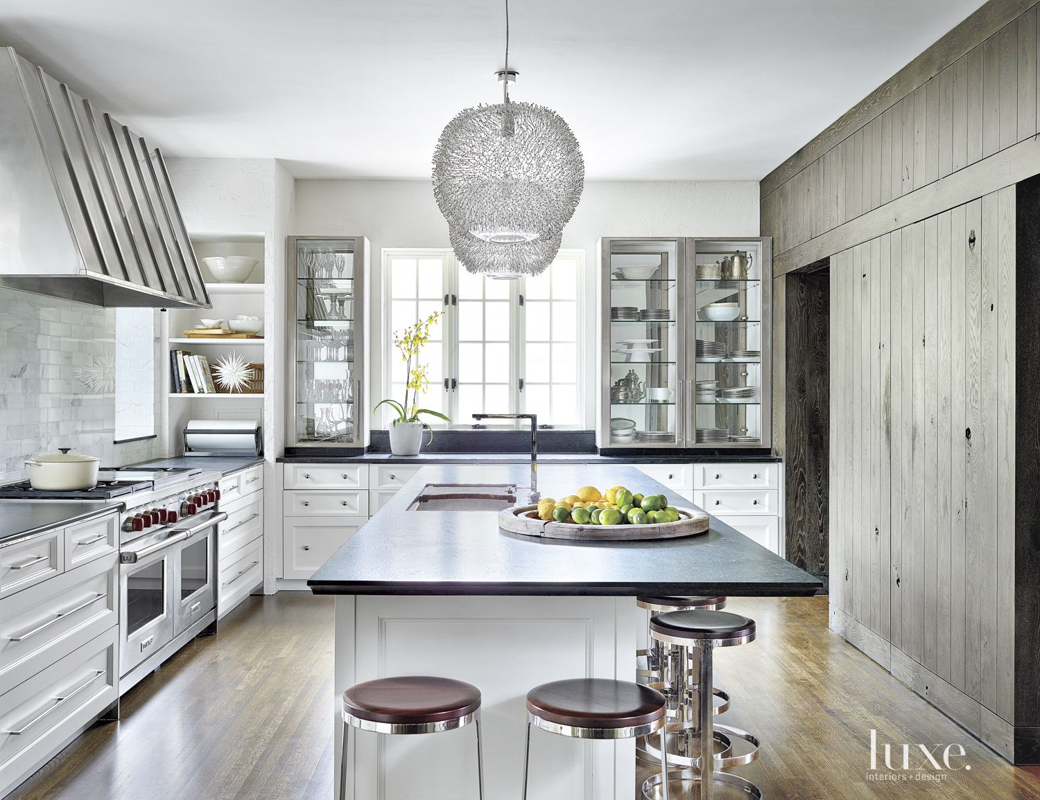 Transitional White Kitchen with Wood Paneled Wall