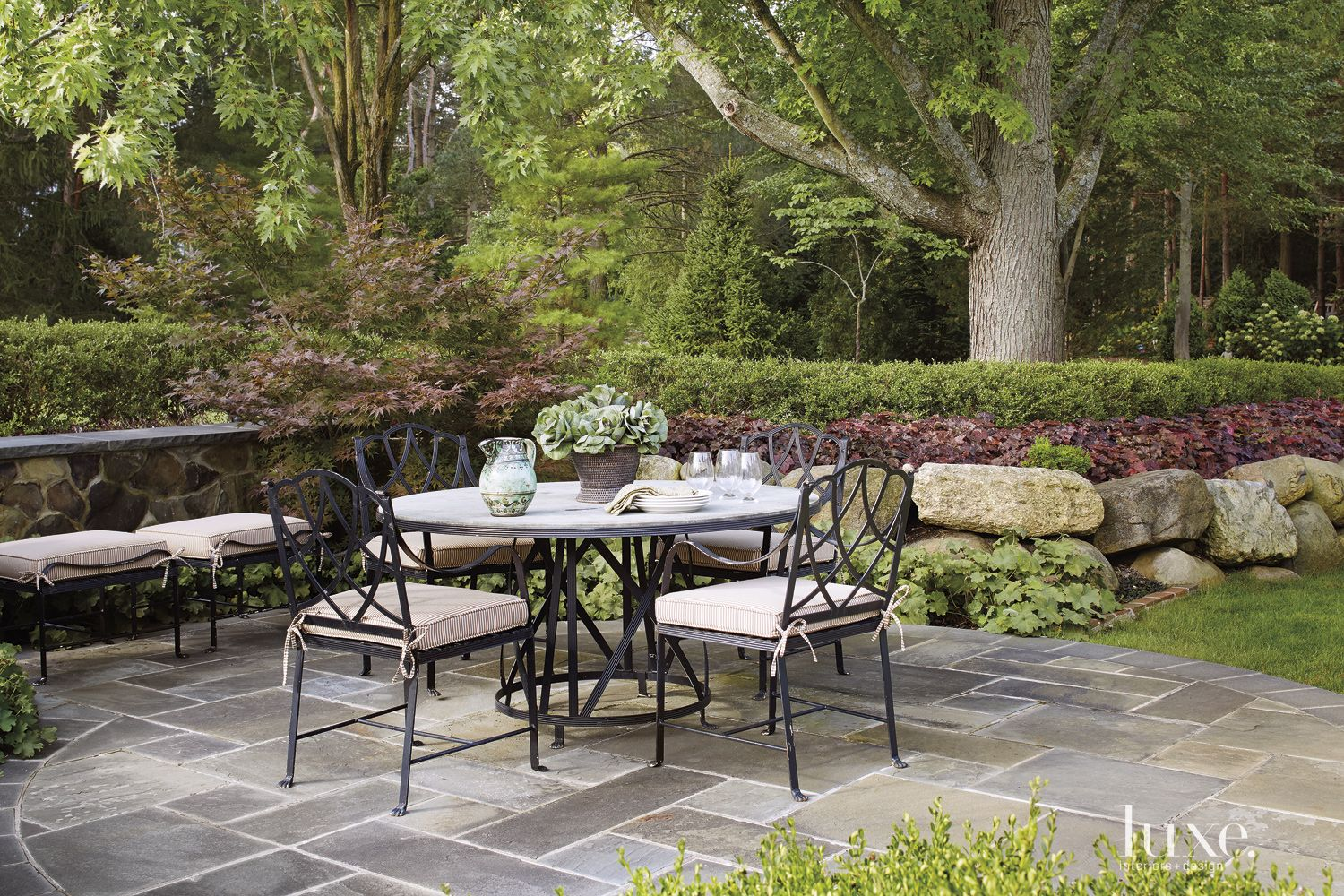 Transitional Outdoor Patio with Stone Wall