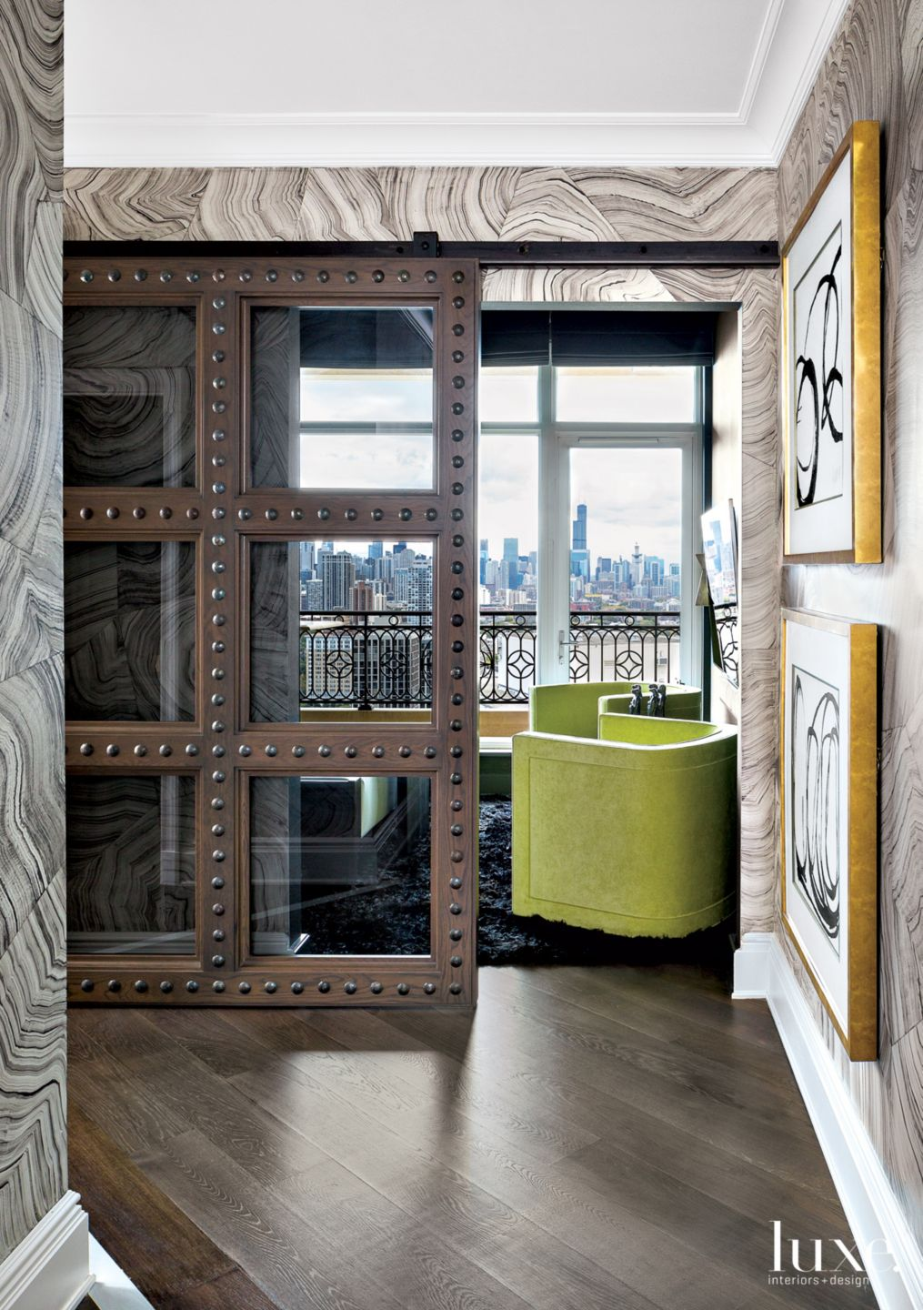 Eclectic Neutral Media Room Entry with Sliding Door