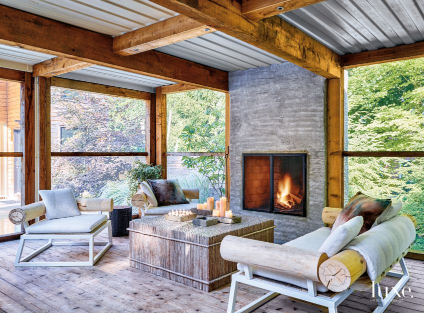 Modern Neutral Screened In Porch With Concrete Fireplace