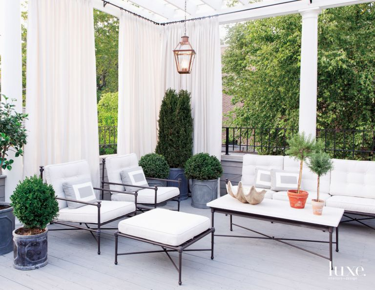 Traditional White Terrace with White Drapes - Luxe Interiors + Design