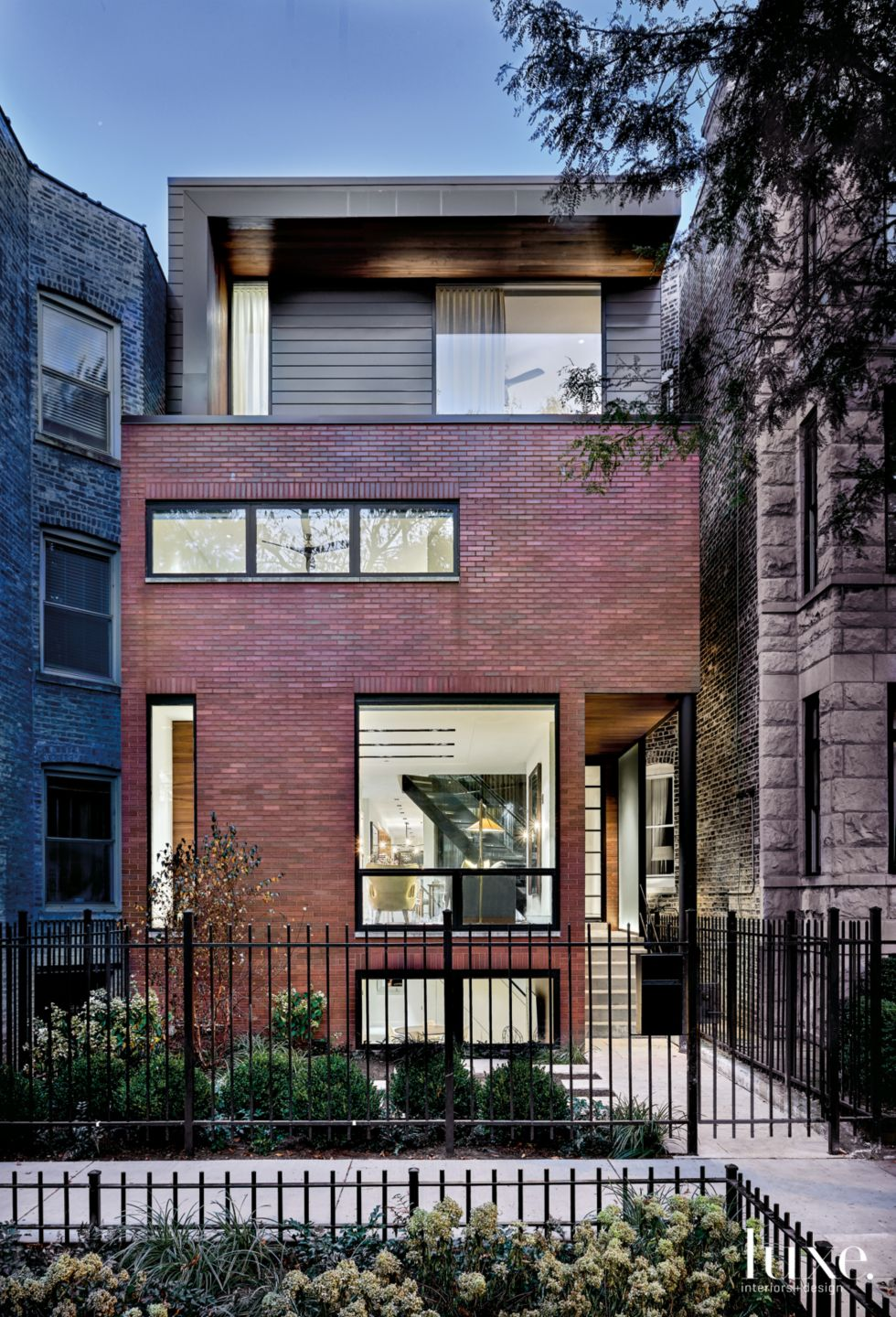 Modern Brick Front Elevation with Custom Charcoal-Metal Panels