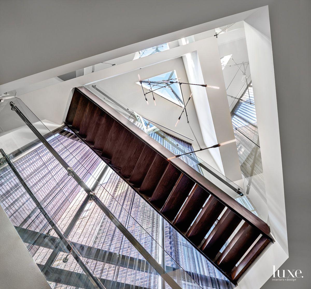 Contemporary White Atrium with Contemporary Light Fixture