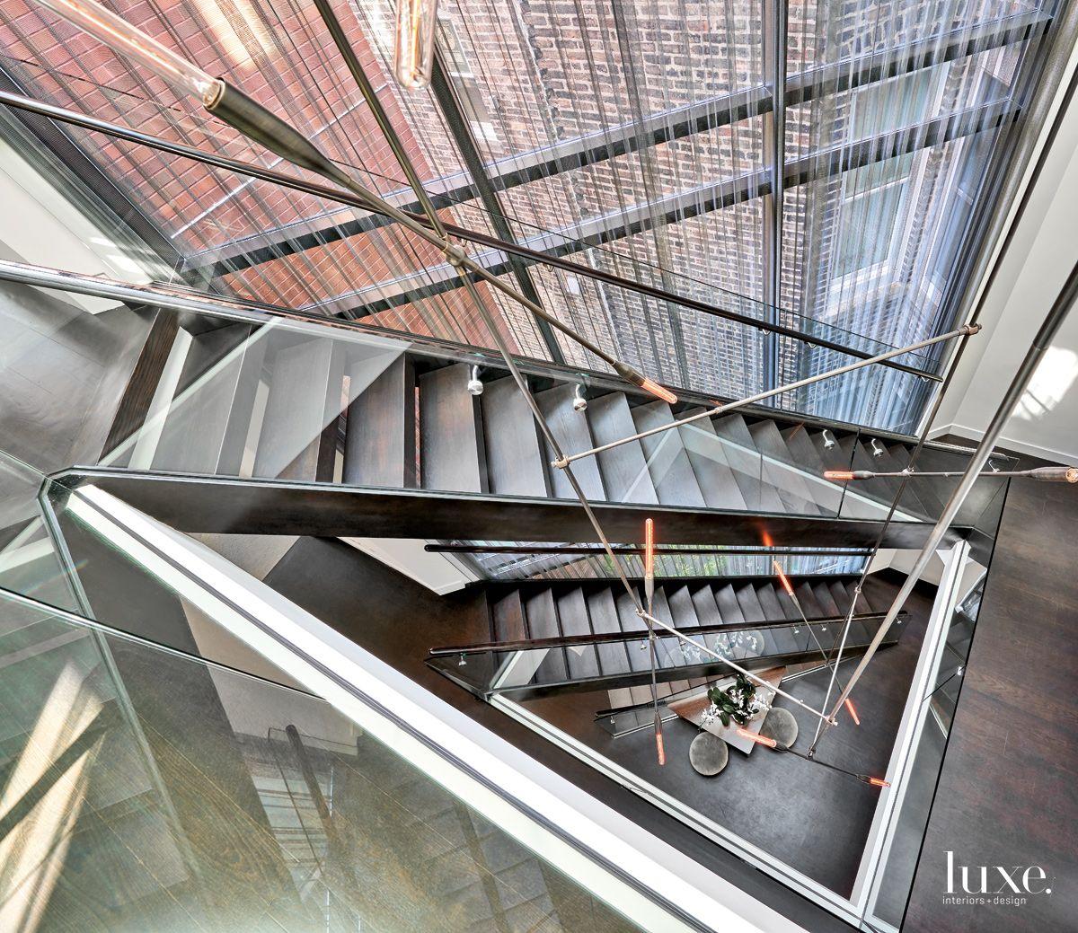 Contemporary Glass Atrium with Triangular-Shaped Skylight