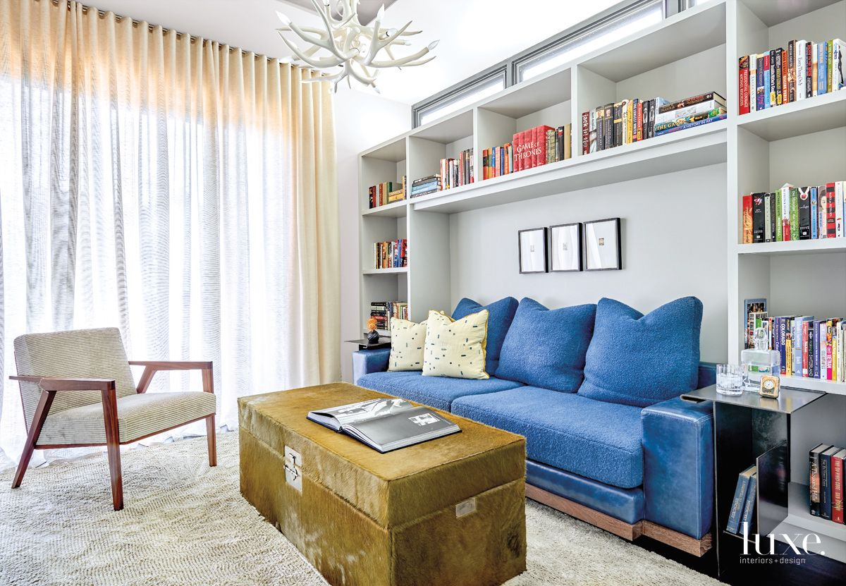 Contemporary White Sitting Room with Hair-on-Hide Trunk