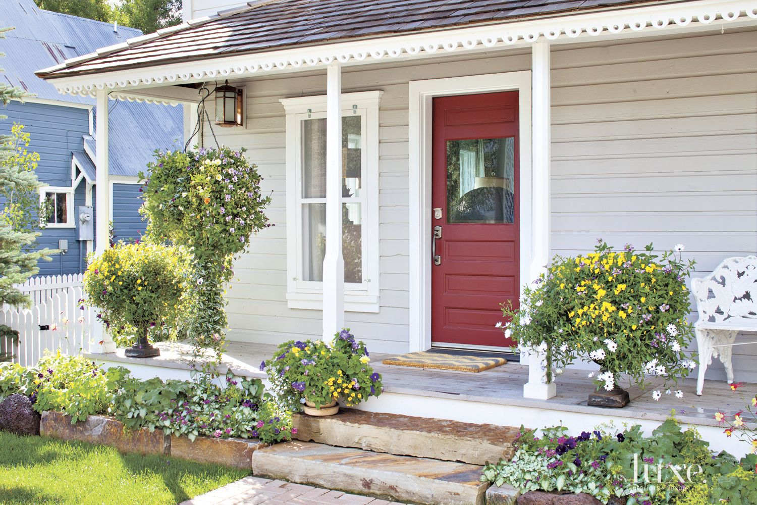 Neutral Mountain Cabin Exterior With Playful Red Door