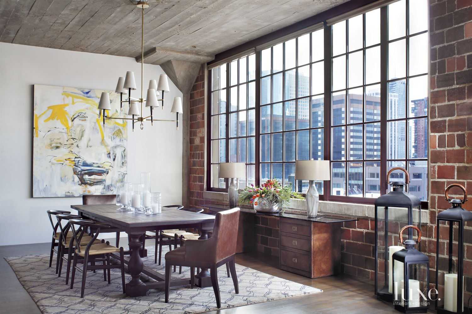 Contemporary White Dining Room with Exposed Brick Wall