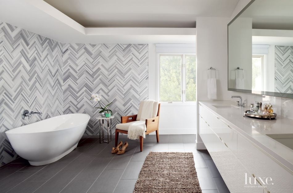 Modern White Bathroom With Herringbone Wall Tiles Luxe