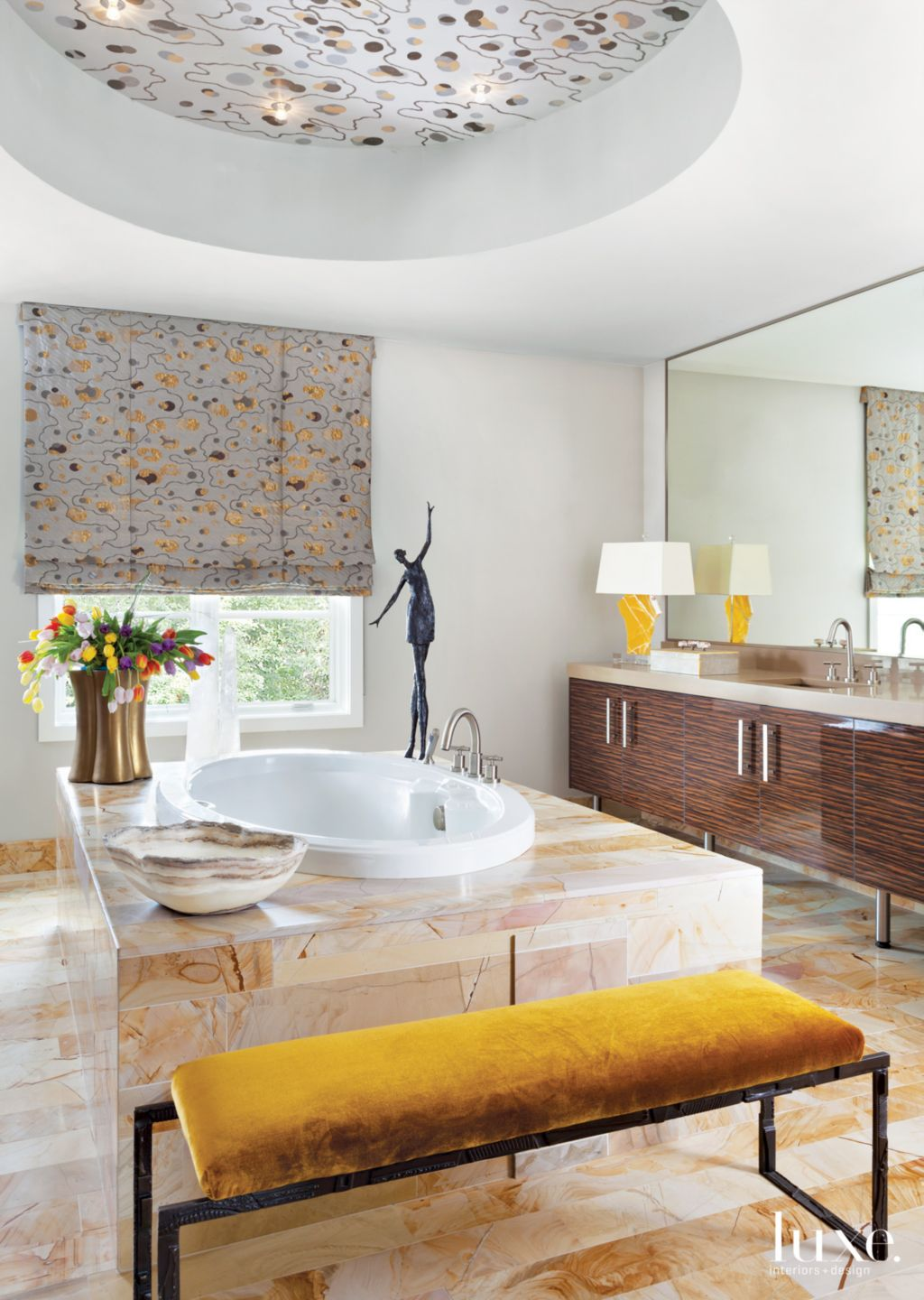 Eclectic White Master Bathroom with Gold-Toned Marble Accents